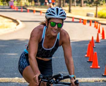 Picture of Jenni Sharff Bertapelle, riding a bike during a triathlon